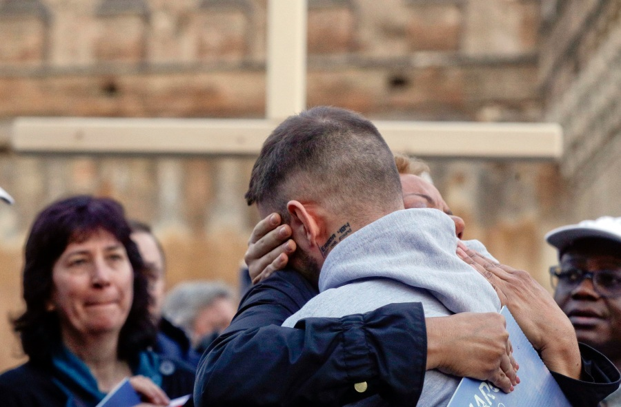 Sex abuse survivor Alessandro Battaglia, right, is hugged by survivor and founding member of the ECA (Ending Clergy Abuse), Denise Buchanan, during a twilight vigil prayer near Castle Sant' Angelo, in Rome, Thursday, Feb. 21, 2019. Pope Francis opened a landmark sex abuse prevention summit Thursday by warning senior Catholic figures that the faithful are demanding concrete action against predator priests and not just words of condemnation. (AP Photo/Gregorio Borgia) Vatican Sex Abuse