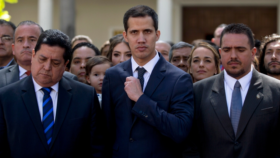 Lawmakers Juan Guaido, center, President of National Assembly, Edgar Zambrano, left, first Vice President and Stalin Gonzalez, right, second Vice President pose for the media after being sworn as new board during a special session at the gardens of National Assembly in Caracas, Venezuela, Saturday, Jan. 5, 2019. Venezuela's opposition-controlled congress holds its first session of the year under new leadership that is promising a more frontal assault on President Nicolas Maduro as he prepares to start a second term widely condemned as illegitimate. (AP Photo/Fernando Llano) Venezuela Political Crisis