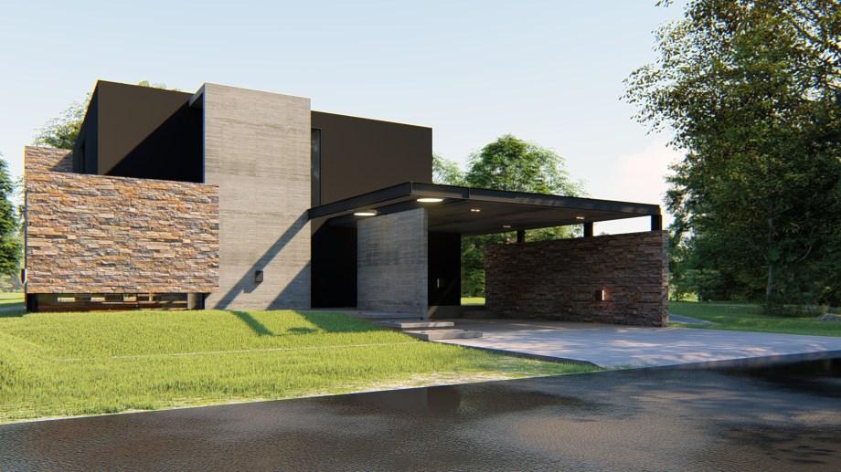La fachada, un muro ciego de piedra y hormigón. De forma no frontal, está la puerta de ingreso.