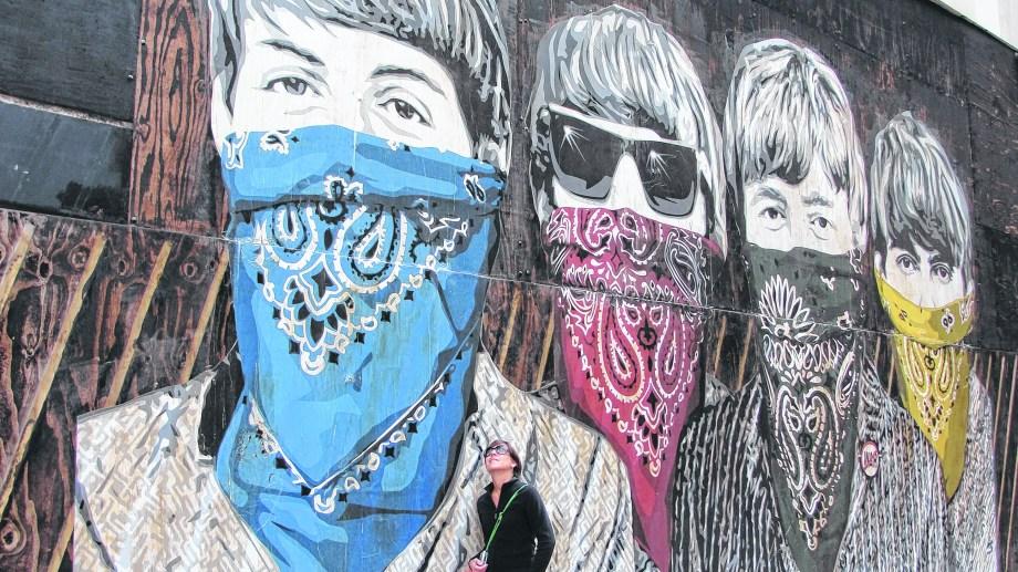 Londres 2012. Los Beatles con el tapabocas