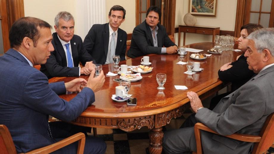 Omar Gutiérrez y Oscar Massei, durante una reunión en el Tribunal Superior de Justicia. (Archivo)