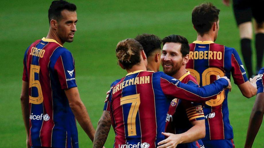 Messi saluda a Griezmann, autor del único gol del encuentro